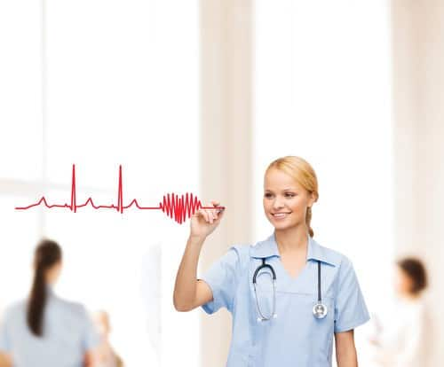 healthcare, medical and technology - young doctor or nurse drawing electrocardiogram